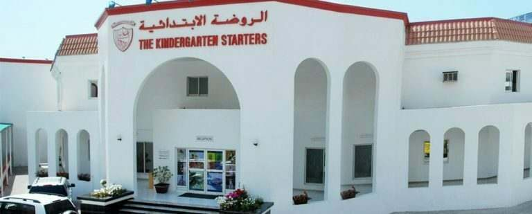 a-kindergarten-school-building-in-the-uae-white-washed-walls-and-english-teacher-standing-outside
