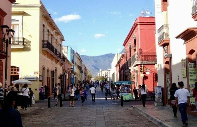 a-beautiful-rural-town-in-mexico-with-english-teacher-and-students-walking-through