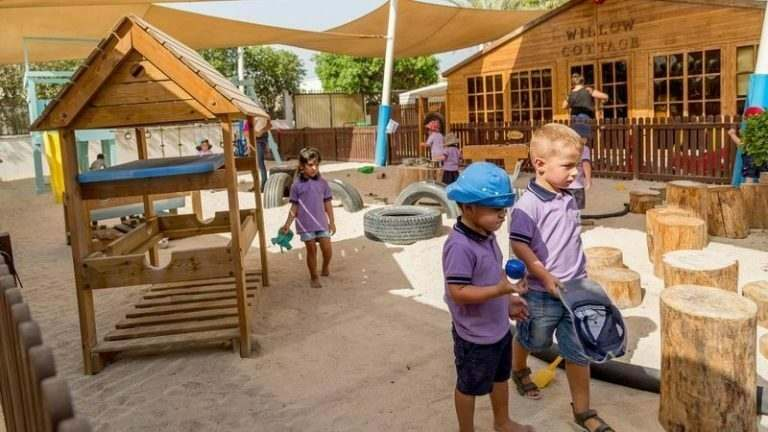 a-fun-nursery-in-the-uae-with-wooden-play-ground-and-children-playing-with-and-international-teacher-supervising