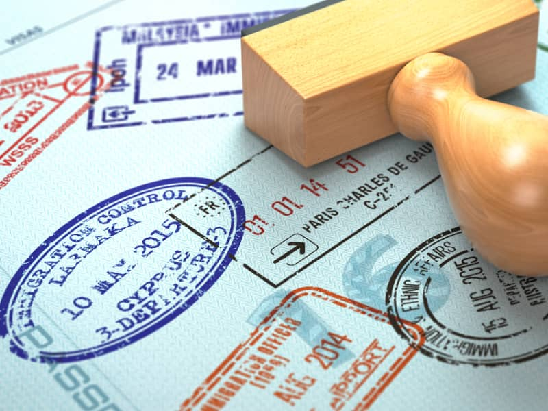 visa-required-to-a-passport-and-passport-stamp-showing-lots-of-stamps-toteach-english-in-vietnam
